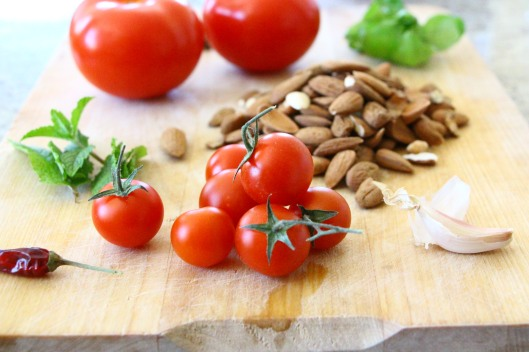 ingredients for one of the best pestos you'll know. tomatoes, capers, almonds,