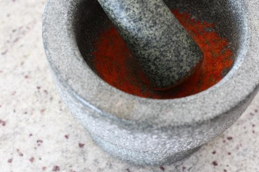 Ground saffron in mortar